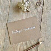 Weihnachtskarte – Heiliger Bimbam. Weißes Lettering auf Kraftpapier